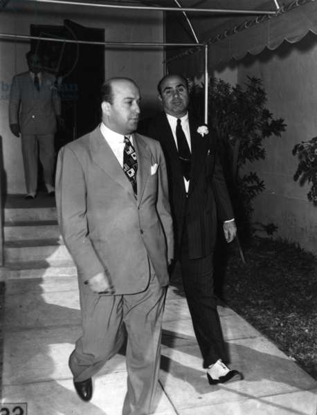 Al Capone (at right) in pin striped suit and spats, c.1935 (b/w photo)