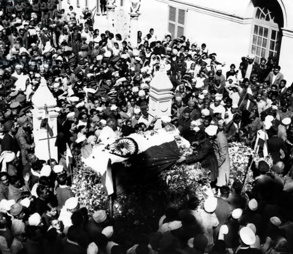 Follwers gather in New Dehli to witness the funeral of Mahatma Gandhi. January 1948