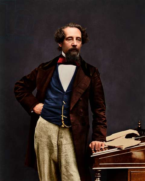 Dickens standing at a desk, right hand on his hip, original image 1859, colourised by Oliver Clyde, 2020 (collodion print)
