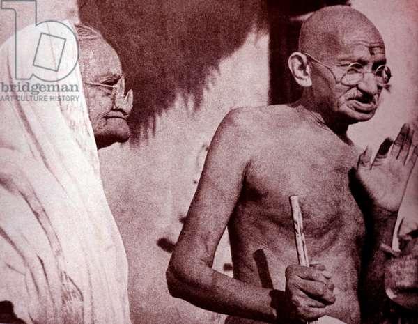 Mahatma Gandhi and his wife Kasturba, at Sevagram a village.