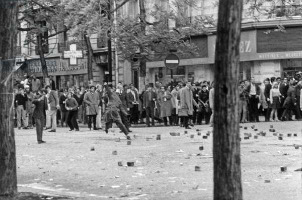 Demonstration of Students in Paris on May 7, 1968 : Theyr Are Throwing Cobblestone on Members of Riot Squad (b/w photo)