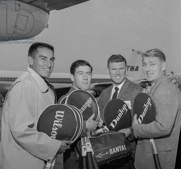 Tennis world championship in Paris : tennismen Alex Olmedo, Ken Rosewall, Frank Sedgman and Lewis Hoad arriving at Orly airport, September 6, 1960 (b/w photo)
