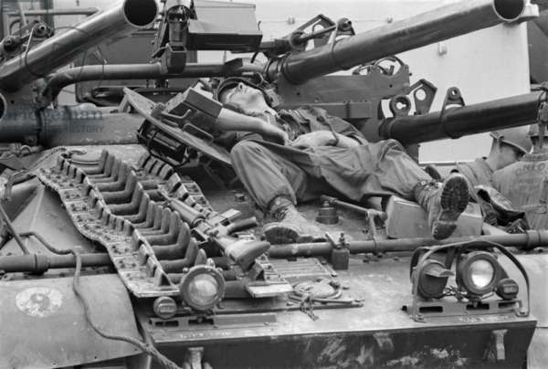 Vietnam War-Tet Offensive. A US Marine relaxes on an Ontos anti-tank vehicle during a break in the fighting at Hue. The 1968 Battle of Hue, was one of the longest battles of the Vietnam War costing US and Allied forces 668 dead and 3,707 wounded. Feb. 23, 1968