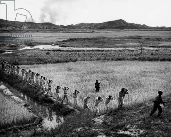 Korean War: U.S. Marines invading North Korea, 1950.