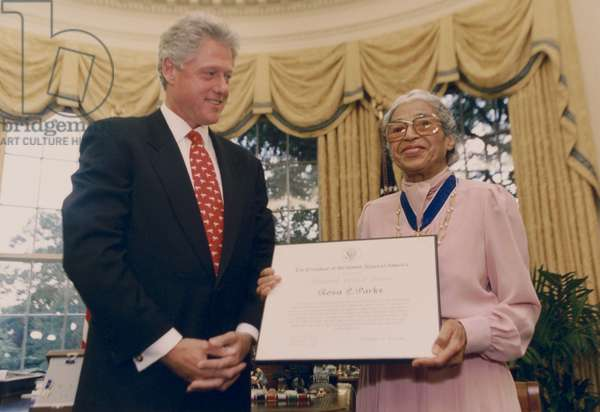 Rosa Parks receives the Presidential Medal of Freedom from President Bill Clinton, Sept. 14, 1996. The African American NAACP activist ignited the Montgomery Bus Boycott on Dec. 1, 1955, by refusing to give her seat in the Negro section of the bus, to standing white passenger (photo)