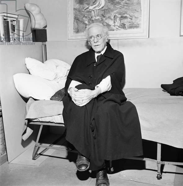 ALFRED STIEGLITZ (1864-1946) American photographer. Photographed in the office of his gallery in New York City, 1945.