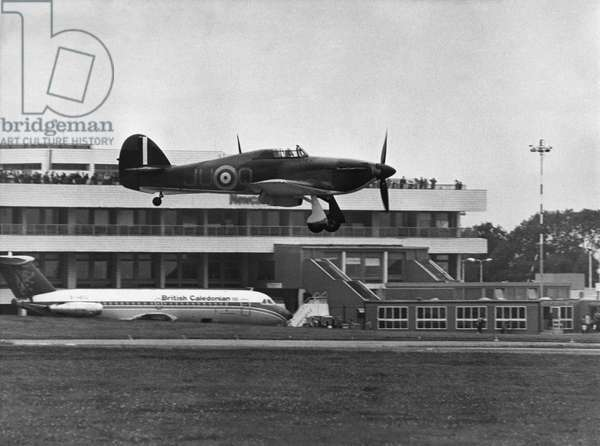 A RAF Hawker Hurricane landing at Newcastle Airport. 25th August, 1979 (b/w photo)
