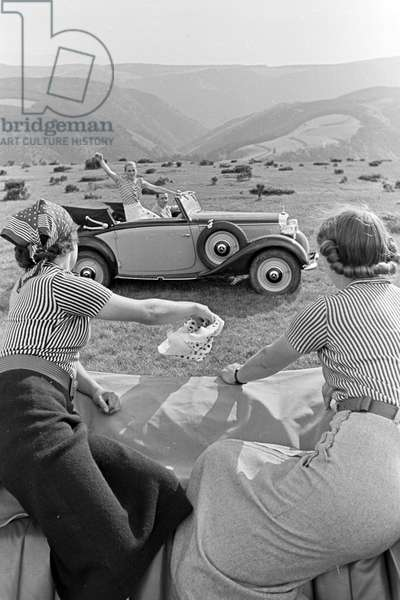 Young people on a trip with their convertibles on the hill Brend in the Black Forest, Germany 1930s (b/w photo)