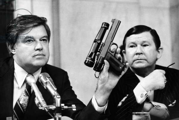 Senator Frank Church was chairman of the Senate Intelligence Committee. As John Tower looks on, he holds a CIA dart gun with a telescopic site. The committee investigated CIA attempts to assassinate foreign leaders, including Patrice Lumumba of the Congo, Rafael Trujillo of the Dominican Republic, the Diem brothers of Vietnam, Gen. René Schneider of Chile, and Fidel Castro of Cuba. Sept. 23, 1975