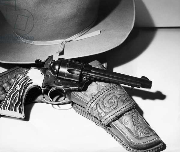 Close-up of a .38 Caliber Bisley Special Colt Revolver and a hat