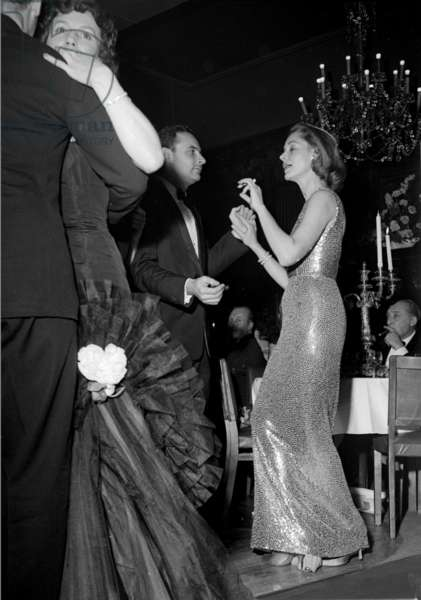 Lauren Bacall with Director Stanley Donen, Society Restaurant, London, UK, 1956 (b/w photo)