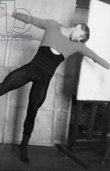 Vladimir Vasiliev posing for painting of Petrushka, Bolshoi Theatre, Moscow, 1964 (b/w photo)