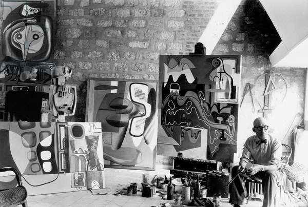 French Painter and Architect Le Corbusier (1887-1965) in his Workshop in Paris C. 1953 (b/w photo)