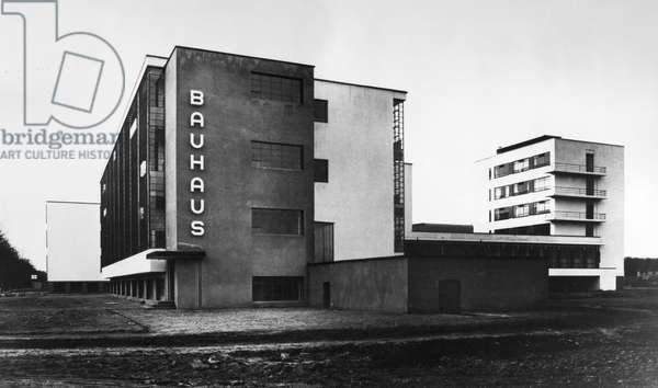 GROPIUS: BAUHAUS, c.1926 The Bauhaus school at Dessau, Germany, with the workshop wing at left and the students' studios at right. Designed by Walter Gropius. Photograph, c.1926.