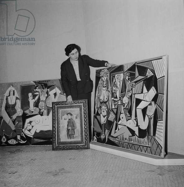Final arrangements before the exhibition of 140 Pablo Picasso's paintings among which 'Women of Algiers' at the Museum of Decorative Arts in Paris, on June 3, 1955