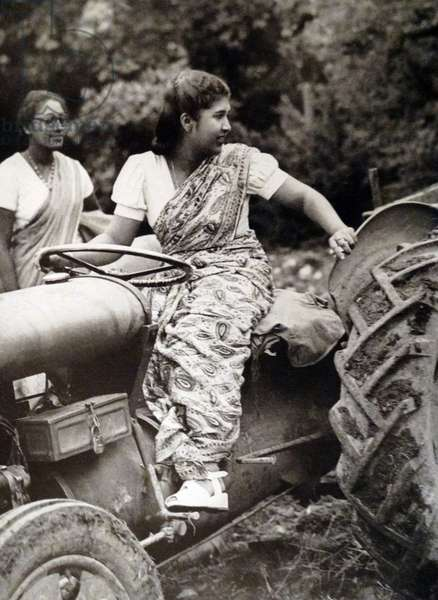 Ceylon Farmerettes leering to drive tractors in England
