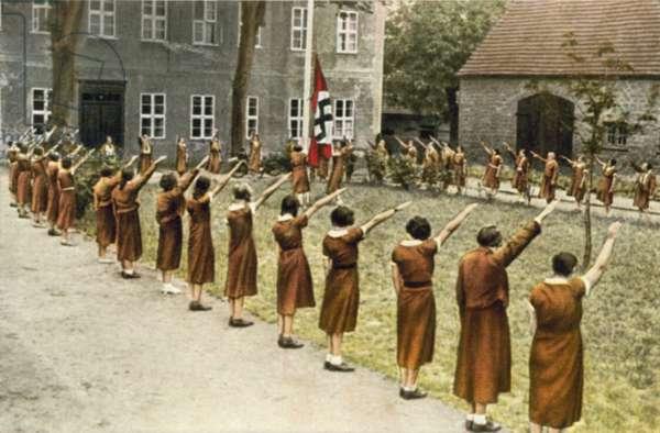 German girls saluting the Nazi flag (colour photo)