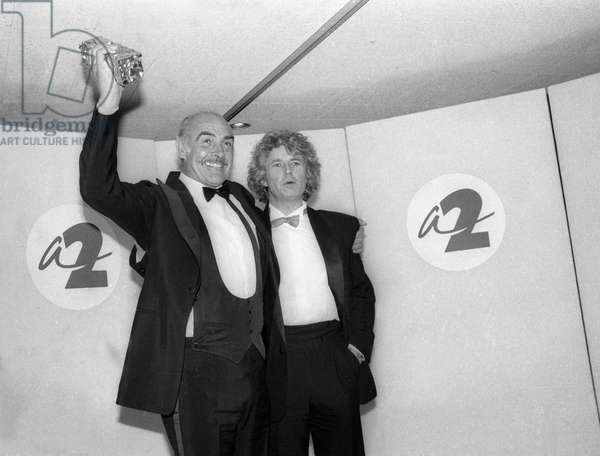 Scottish actor Sean Connery and French film director Jean Jacques Annaud at the he 12th Cesar Awards ceremony in Paris on Mars 9, 1987 - 'The Name of the Rose' was awarded the Cesar for best foreign film