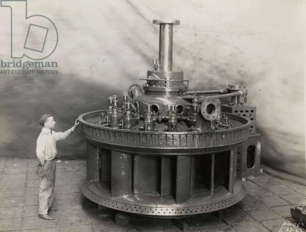Shop assembly of the first hydraulic turbine built at Newport News, 1923 (b/w photo)