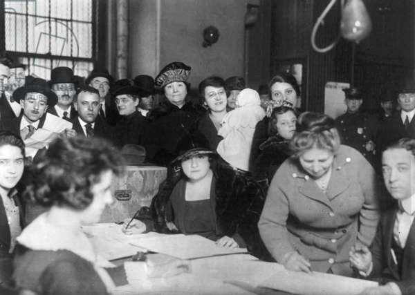 VOTING POLL, 1922 Men and women at voting poll on Oliver and Henry Streets in New York City. Photograph, 1922.