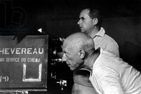 painter Pablo Picasso with director Henr-Georges Clouzot on set of film The Mystery of Picasso in 1955