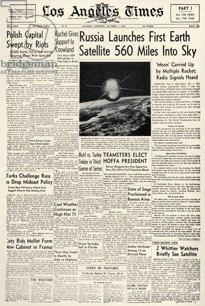SPUTNIK I, 1957 'Russia Launches First Earth Satellite 560 Miles Into Sky' Front page of the Los Angeles Times reporting on Sputnik I, the first human-made object to orbit the Earth. 5 October, 1957.