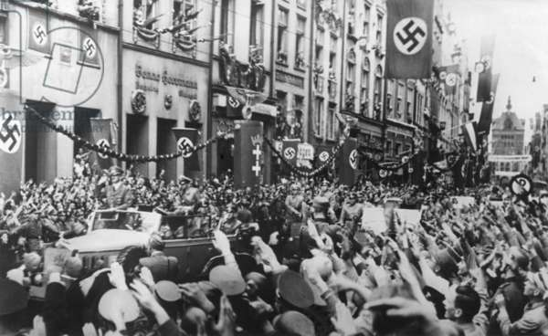 Danzig (Gdansk) greets the Fuhrer on Sept. 19, 1939. German Chancellor, Adolf Hitler receives Nazi Salutes as his rides in victory through Danzig. In the 1930s, the majority of the Danzig's population was German, since the city was part of Germany before WW1. World War 2