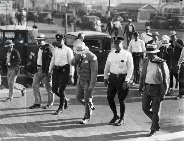 Al Capone under arrest in Miami Beach, May 1930 (b/w photo)