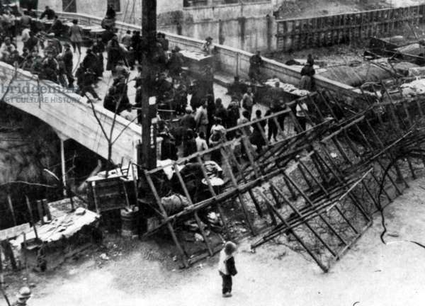 China: A barricade hastily erected by the British at the Shanghai International Settlement during the Japanese invasion of Shanghai in 1937.