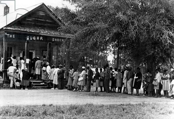 5/3/66--PEACHTREE, ALA--African Americans flock to this polling place in rural, Blackbelt, Alabama 5/3 as they vote in large numbers for the first time in history. Typical of rural polling places is the Sugar Shack small store in Wilcox County where black people outnumber whites almost 3 to 1.