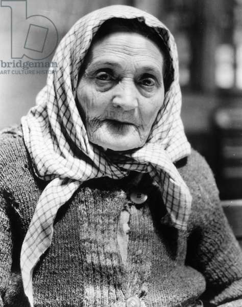 IMMIGRANTS: ELLIS ISLAND An immigrant woman at Ellis Island. Photograph by Lewis Wickes Hine, 1926.