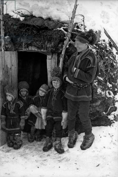 Lapps wearing traditional suits, during the travel in Swedish Lapland, Kiruna, March, 1939 (b/w photo)
