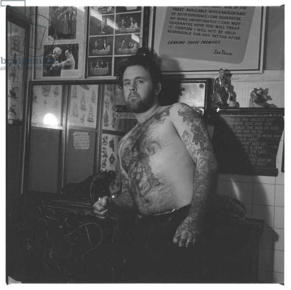 Les Skuse, tattoo pioneer, portrait of man with tattoos by Les Skuse a stalwart of British tattoo scene, Bristol, mid 1950's
