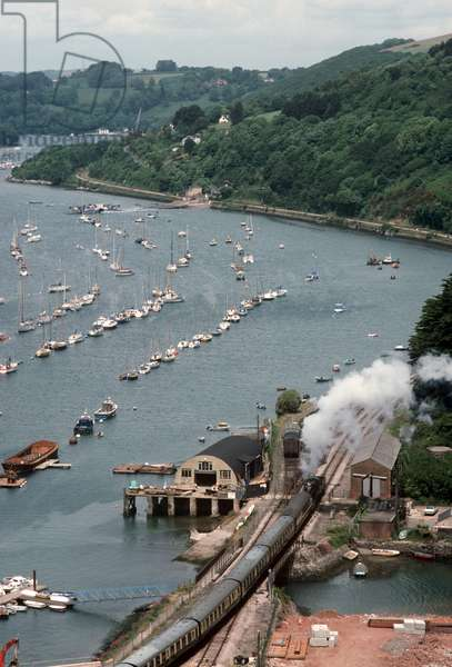 Steam train pulling out of Kingswear and Dartmouth station on the Heritage Dartmouth Steam Railway, Devon, England, UK, 1989 (photo)
