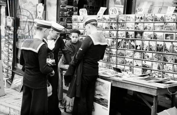 British sailors buying postcards (b/w photo)