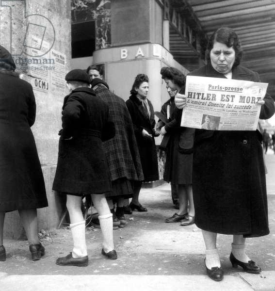 French Woman Reading Newspaper (Paris-Presse) Announcing Death of Adolf Hitler in April 1945 (b/w photo)