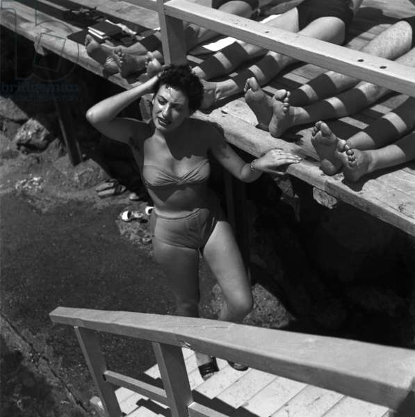 Bathers by the sea: 'The bather between the feet', Paraggi, Genoa, July 1952 (b/w photo)