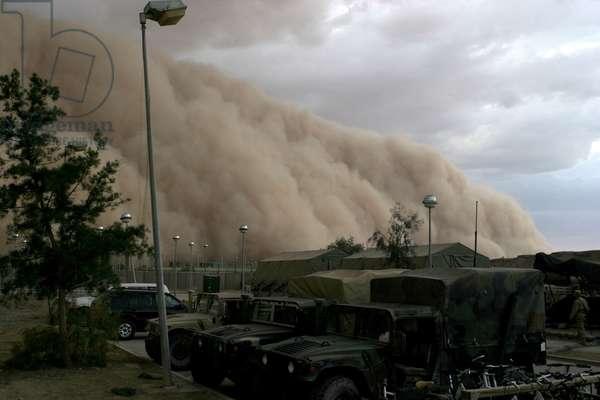 A massive sand storm envelopes a U.S. military camp in Al Asad Iraq. April 27 2005