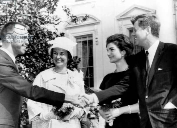 Astronaut Alan Shepard Jr. (1923-1998), and Louise Shepard, are greeted by Jacqueline Kennedy, and John F. Kennedy, after arrival at the White House, May 8, 1961
