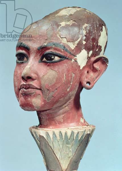 Head of the child king Tutankhamun (c.1370-52 BC) emerging from a lotus flower, found at the entrance of the tomb, New Kingdom (stuccoed & painted wood) (see also 228554)