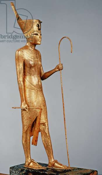 Statuette of the king wearing the red crown of the north, from the tomb of Tutankhamun (c.1370-52 BC) New Kingdom (gilded wood)
