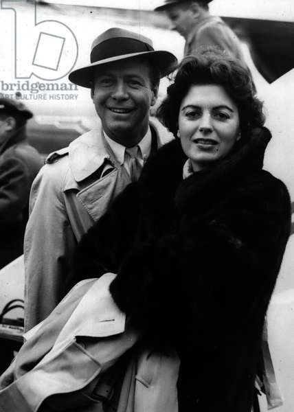 """Jan. 01, 1955 - Stars Arrive From The United States For New Film In Britain; Among the arrivals at London Airport from Hollywood this morning were screen stars Miss Faith Domergue and Gene Nelson. They are to take part in their first British picture"""" Time Slip"""" for Anglo-Amalgamated"""