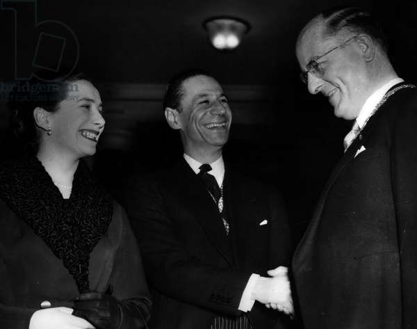 Jan. 01, 1955 - Hague Burgomaster visits London; In connection with the consideration of a proposal to build a Congress Hall at the Hague, the Burgemaster (Mr. F.M.A. Schokking) and other representatives of the council of the Hague, are now visiting London in order to study buildings here the Royal Festival Hall, Kidbrooke School and Church House. They launched today at the Country Hall
