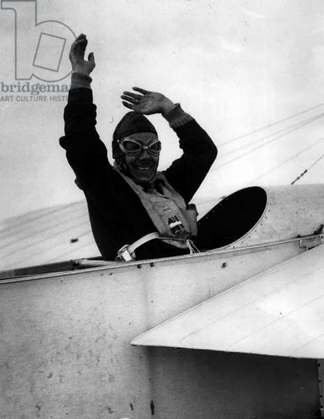 """Jan. 01, 1955 - Mr. Jean Salis flies channel in"""" Bleriot"""" replica. Waves to the crowds.: Fifty year old Frenchman M. Jean Salis landed at Ferryfield, near Lydd, Kent, last evening after flying from Calais in his replica of the machine used by M. Louis Bleriot 46 years ago. The 47 miles flight took 81 minutes"""