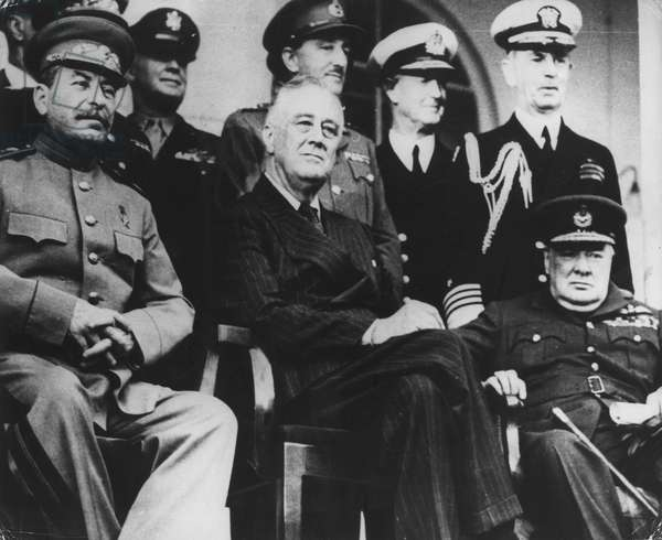 Nov 29, 1943 - Tehran, Iran - Historical encounter between General Secretary of the Communist Party JOSEPH STALIN, the U.S. President FRANKLIN D. ROOSEVELT and U.K. Prime Minister Sir WINSTON CHURCHILL during the Teheran Conference. The Tehran Conference (codenamed Eureka) was a strategy meeting held between Joseph Stalin, Franklin D. Roosevelt, and Winston Churchill from November 28 to December 1, 1943. It was held in the Soviet Embassy in Tehran, Iran and was the first of the World War II conferences held between all of the 'Big Three' Allied leaders (the Soviet Union, the United States, and the United Kingdom). During the Conference, the three leaders coordinated their military strategy against Germany and Japan and made a number of important decisions concerning the post World War II era. The most notable achievements of the Conference focused on the next phases of the war against the Axis powers in Europe and Asia. Roosevelt, Churchill, and Stalin engaged in discussions concerning the terms under which the British and Americans finally committed to launching Operation Overlord, an invasion of northern France, to be executed by May of 1944. (Credit Image:
