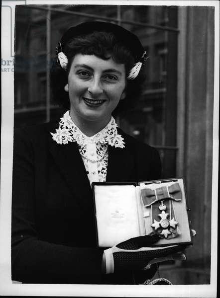 Jul 07, 1953 - World Champion Skating Star Receives The O.B.E.. Jeanette Altwegg Waiting Investiture.. Among the visitors to Buckingham Palace to receives their awards - was Miss Jeanette Altwegg the famous Britain and World Amateur Ice Skating Champion.. She received the Most Excellent Order of the British Empire.. Keystone Photo Shows: - Jeanette Altwegg displays her medal - after the presentation at Buckingham Palace.