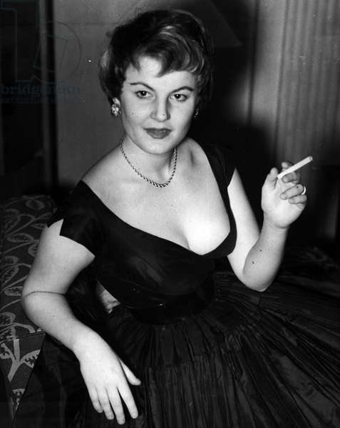 """Jan. 01, 1955 - Hollywood film Magnet's daughter London. Susan Hakim. the 21 years old daughter of Hollywood film magnet, Darryl F. Zanuck, vice president of twentieth century Fox, Arrived in London with her husband yesterday. producer and they were married eight months ago. they are in London to find an all - British cast for the film version of"""" The man who never was"""". Susan is a cabaret singer but has never made a movie"""