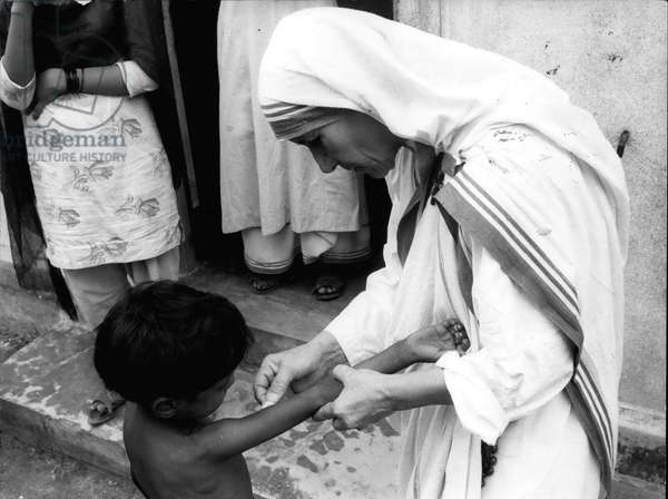 mother Teresa (Theresa) - Mother Teresa is kept busy at the children's clinic, where out-patients are treated