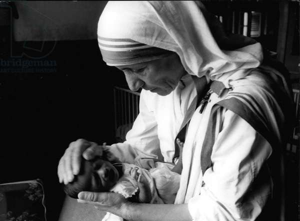 mother Teresa (Theresa) - The hands of Mother Teresa bring comfort and security to an orphaned baby who seems almost too aware of suffering