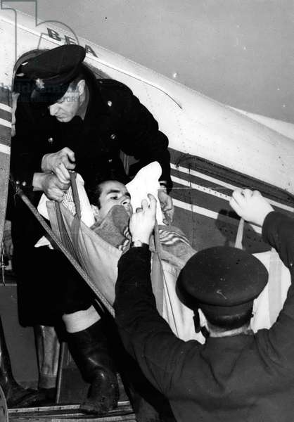 Jan. 01, 1955 - Shot Boy Rioter Arrives In London - And Then Flies To Edinburgh For Treatment: Nineteen year old Renos Pouyoukas students who was shot when British troops opened fire during anti-British riots in Cyprus arrived by air in London last night - and left again by air this morning for Edinburgh where is to be seen by Mr. Norman Dott the professor of neuro-surgary at Edinburgh University. The boy was paralysed by a bullet which entered his spine. The Cyprus Government is paying for the journey and the treatment